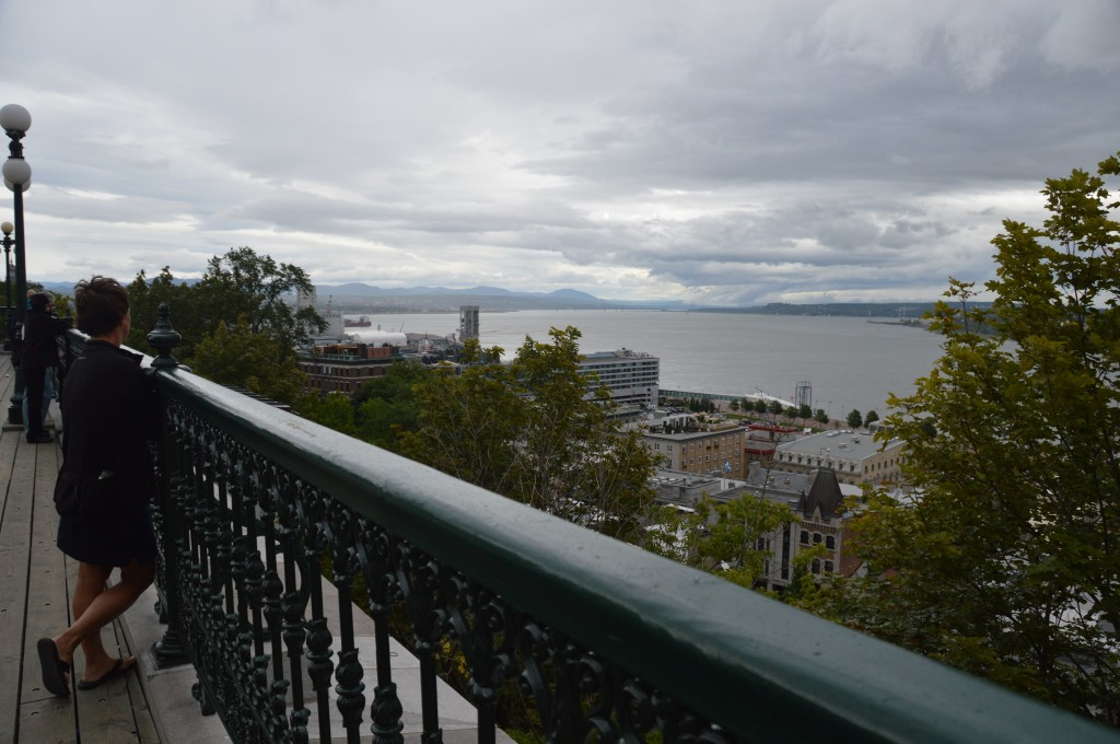Joyce on the promenade at the foot of Chateau Frontenac peering east over St. Lawrence