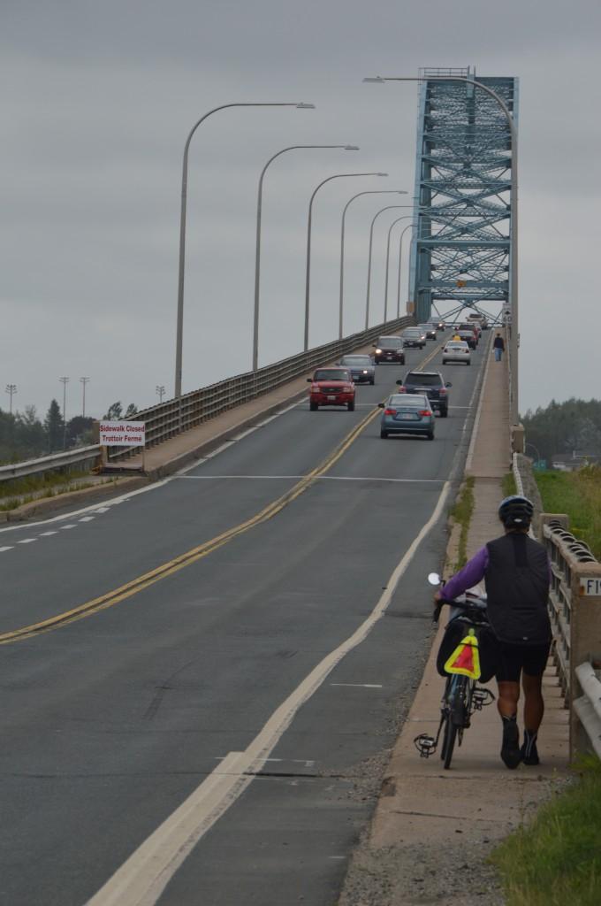 Joyce approaching the high, narrow bridge