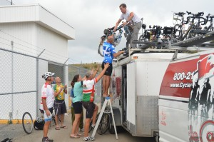 concerted effort to load bikes atop vehicle bound for Newfoundland